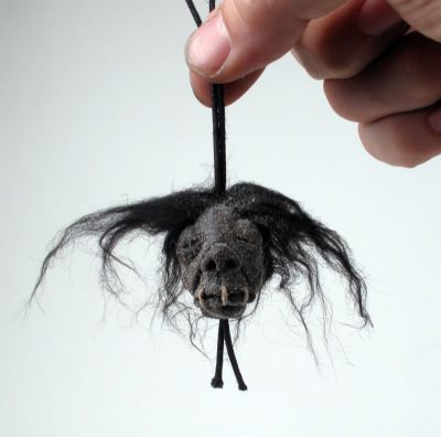 Shrunk'n Shrunken Head, held by hand